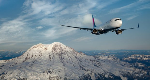Boeing 737-900ER in flight near Mount Rainier, Seattle, WA.  -  These images are protected by copyright.  Delta has acquired permission from the copyright owner to the use the images for specified purposes and in some cases for a limited time.  If you have been authorized by Delta to do so, you may use these images to promote Delta, but only as part of Delta-approved marketing and advertising.  Further distribution (including proving these images to third parties), reproduction, display, or other use is strictly prohibited.